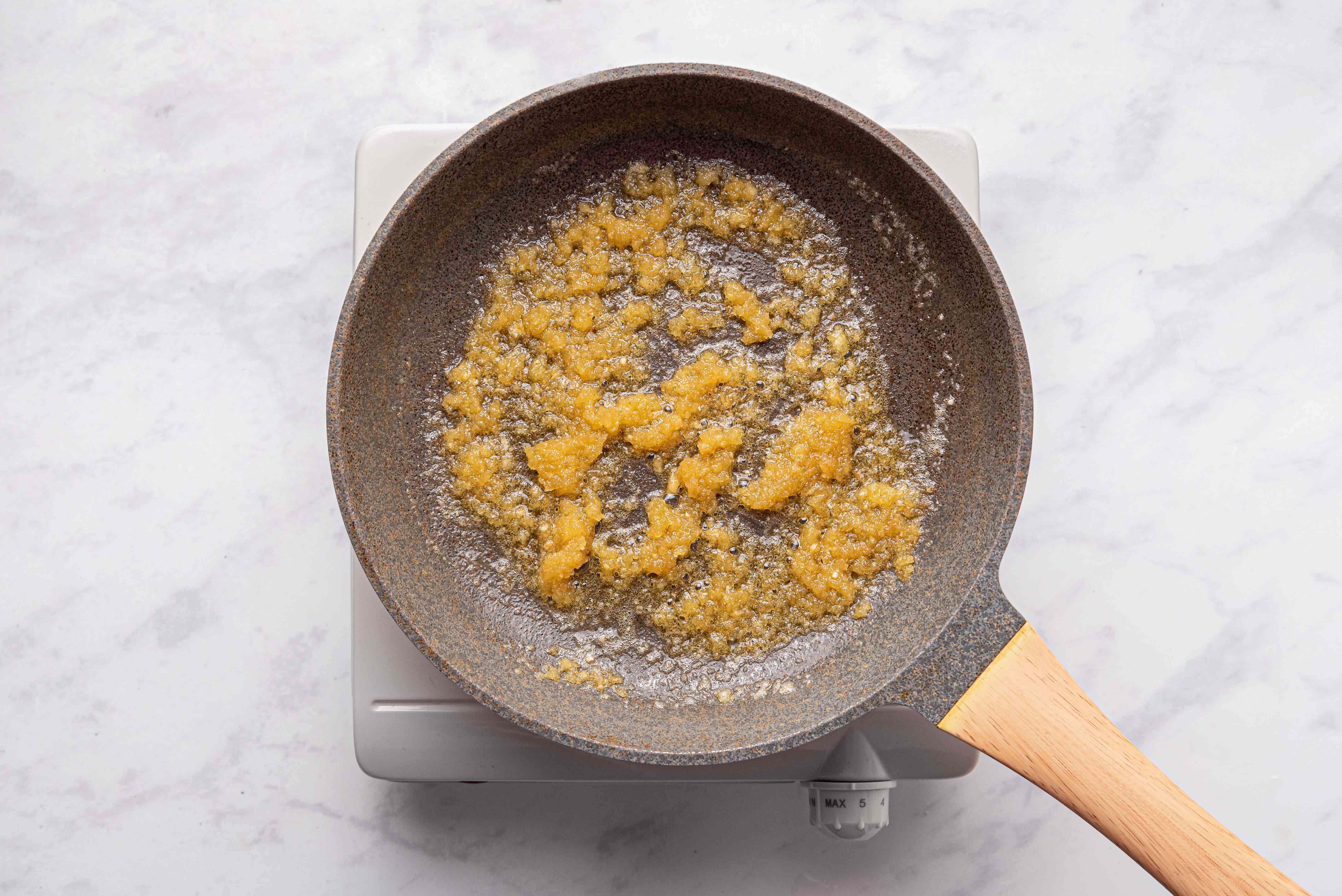 Buttered breadcrumbs in skillet