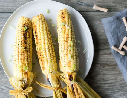 Smoked corn on the cob on a plate