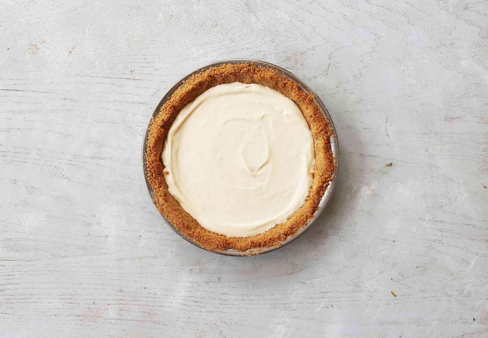 Cream cheese filling in graham cracker crust