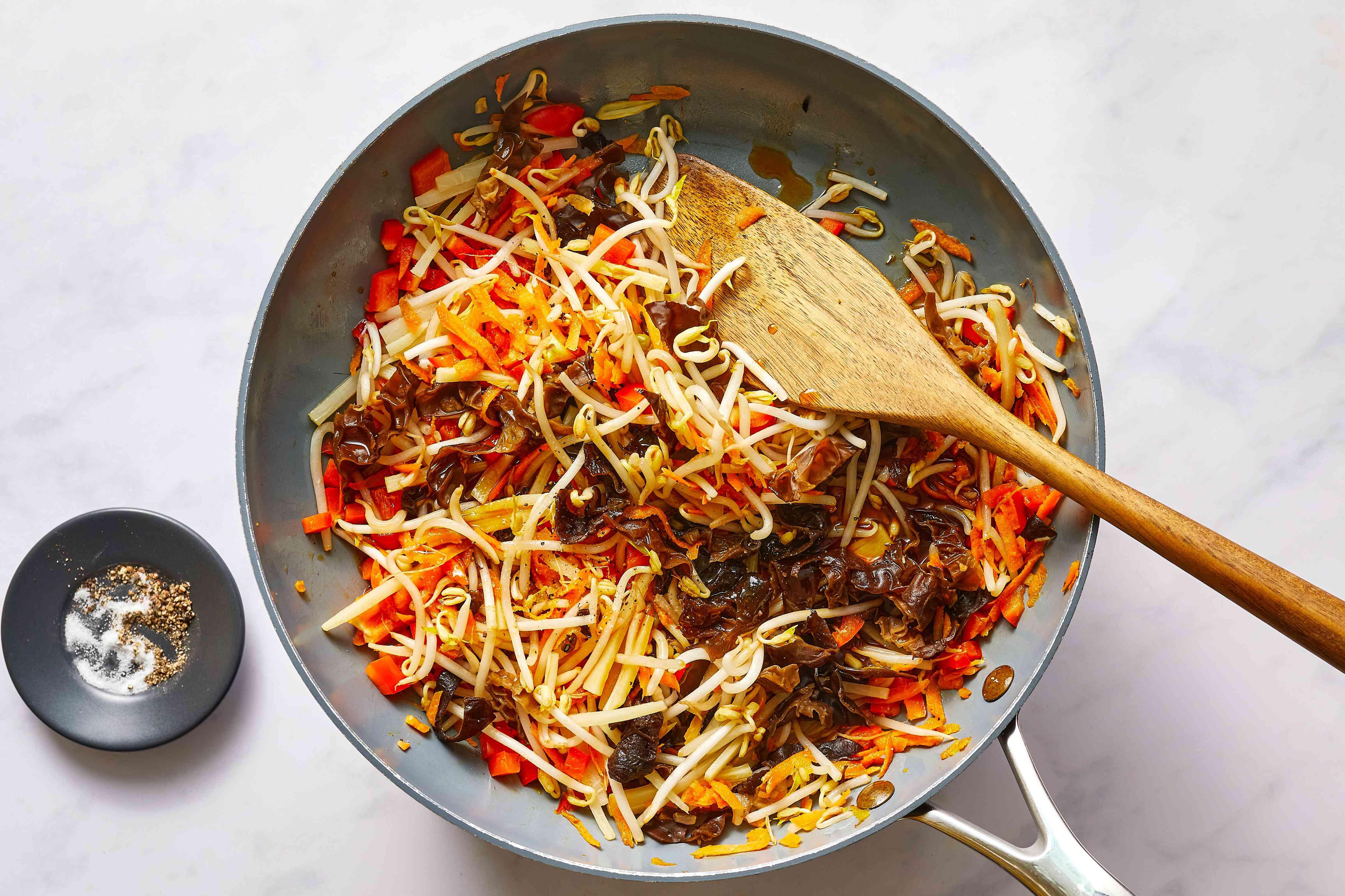 seasoned vegetables cooking in a pan