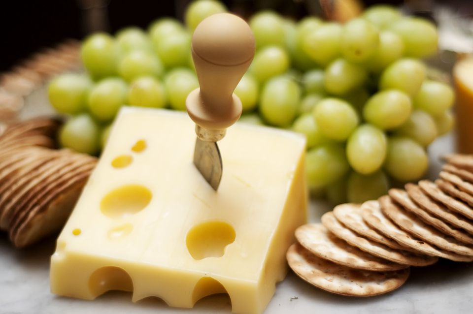 swiss cheese, crackers and grapes