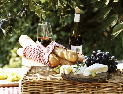 Still life with soft cheese, grapes, baguettes & red wine