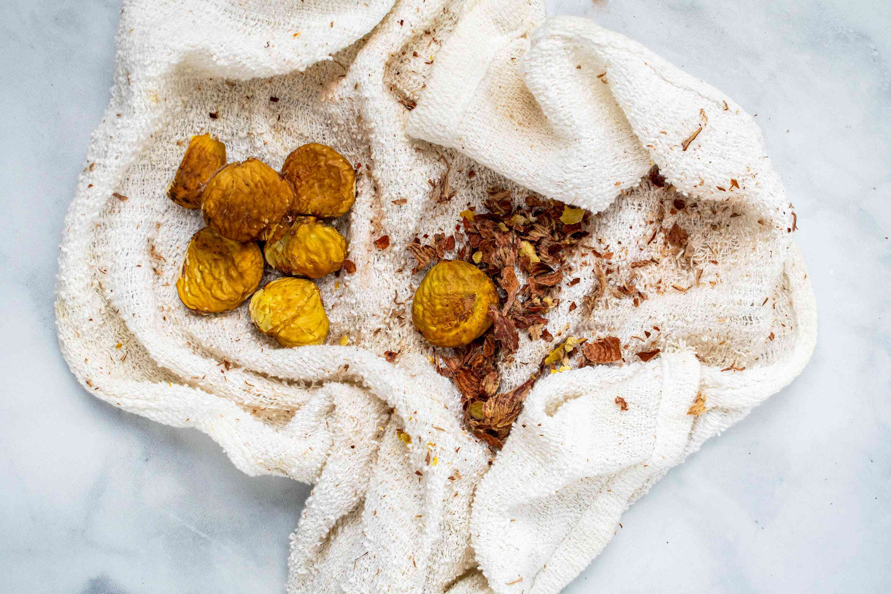 Rub the nuts into a hand towel to remove the inner skins