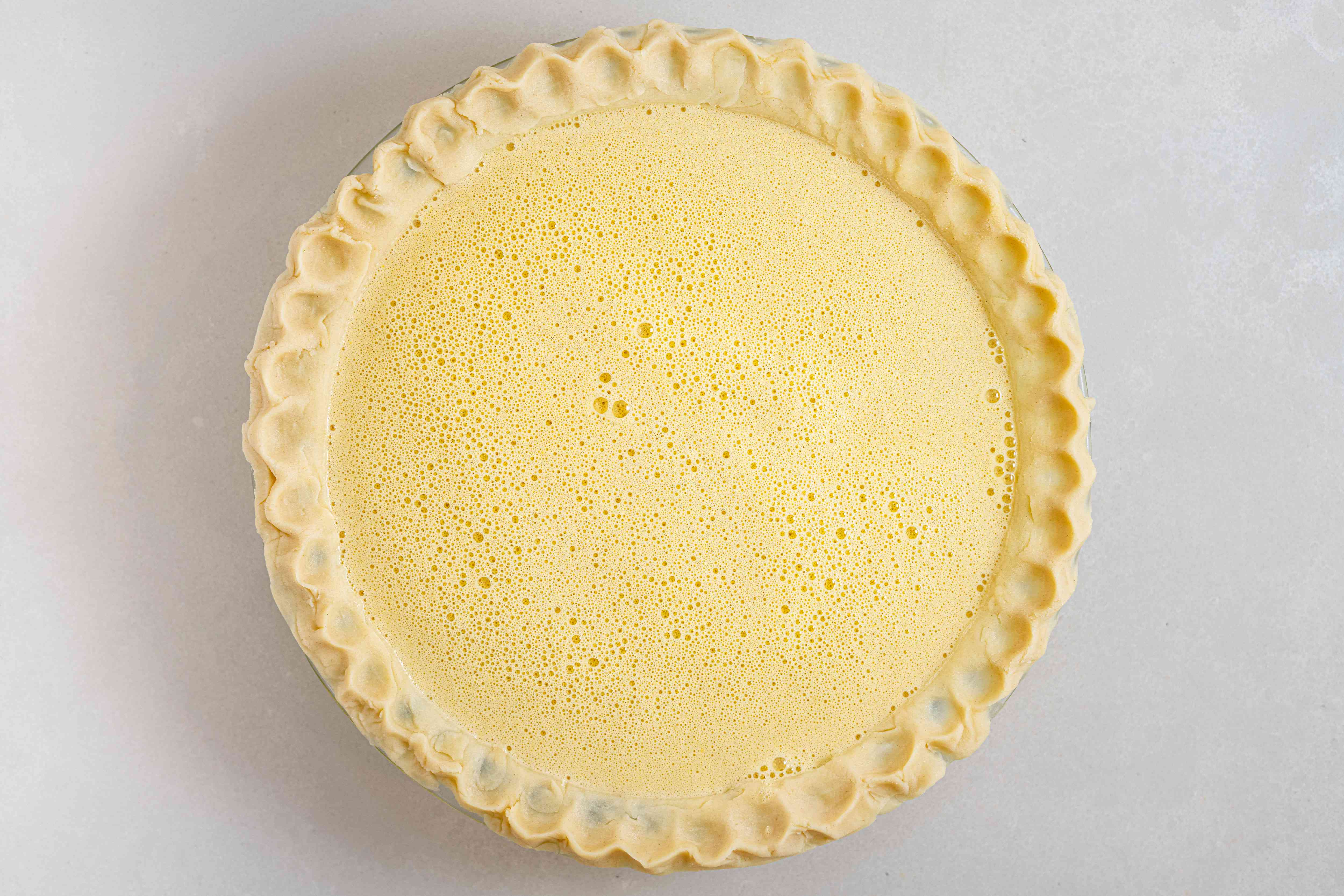 Pour the egg mixture into the prepared crust