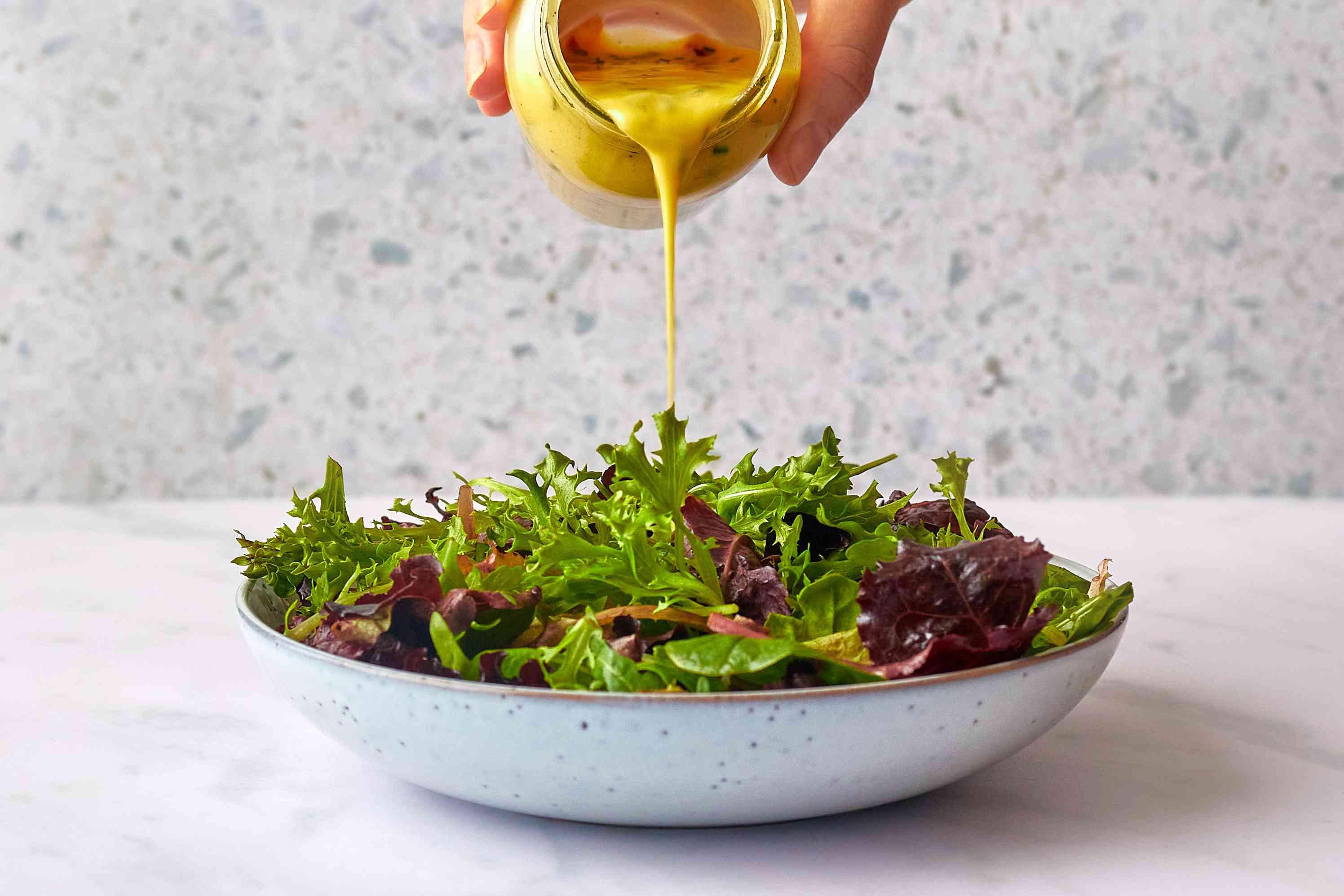 Easy Mustard Jar Salad Dressing poured over salad