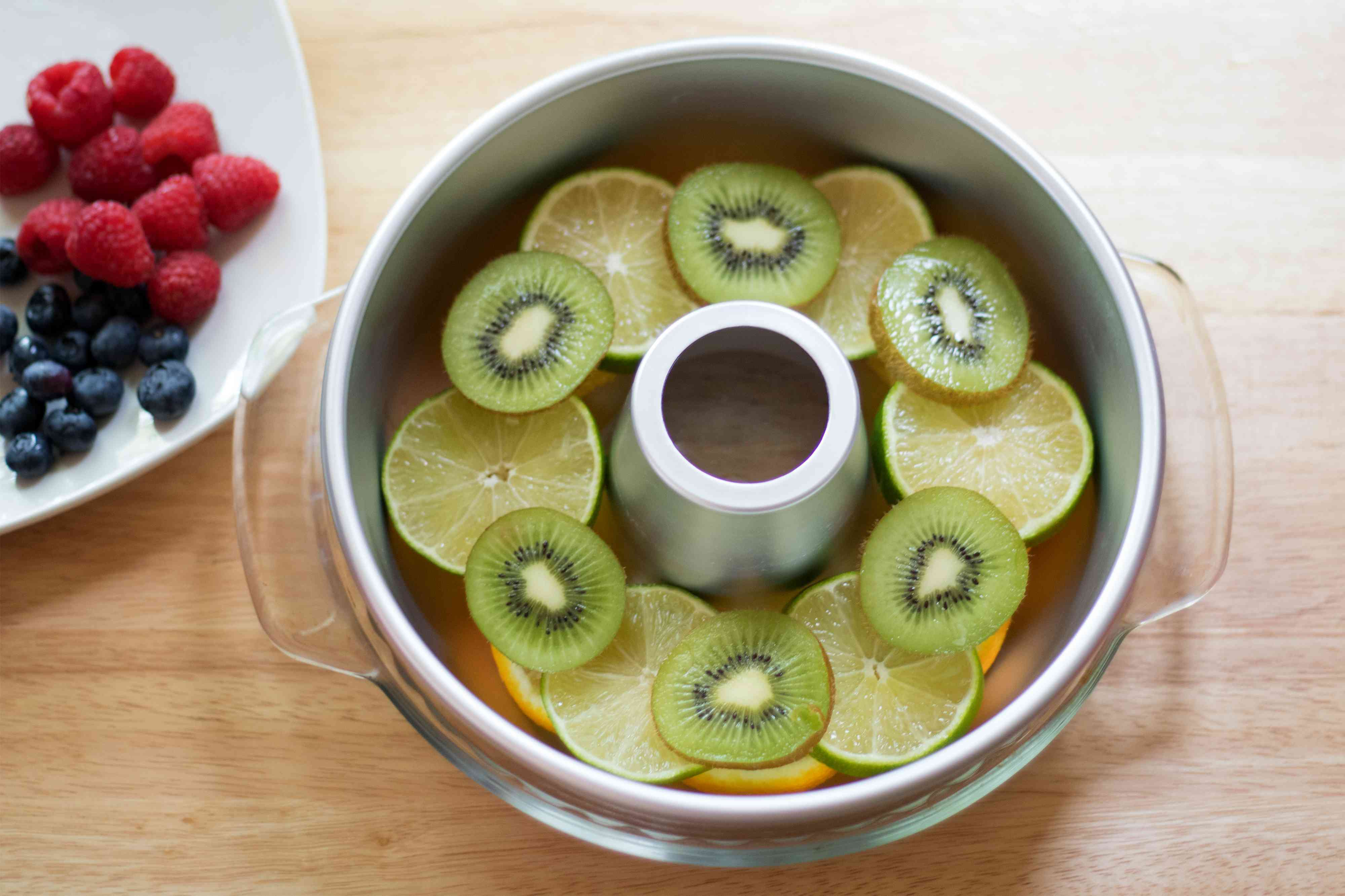 Layer Fruit Slices for Punch Bowl Ice Ring