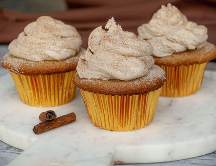 Snickerdoodle cupcakes on a marble tray