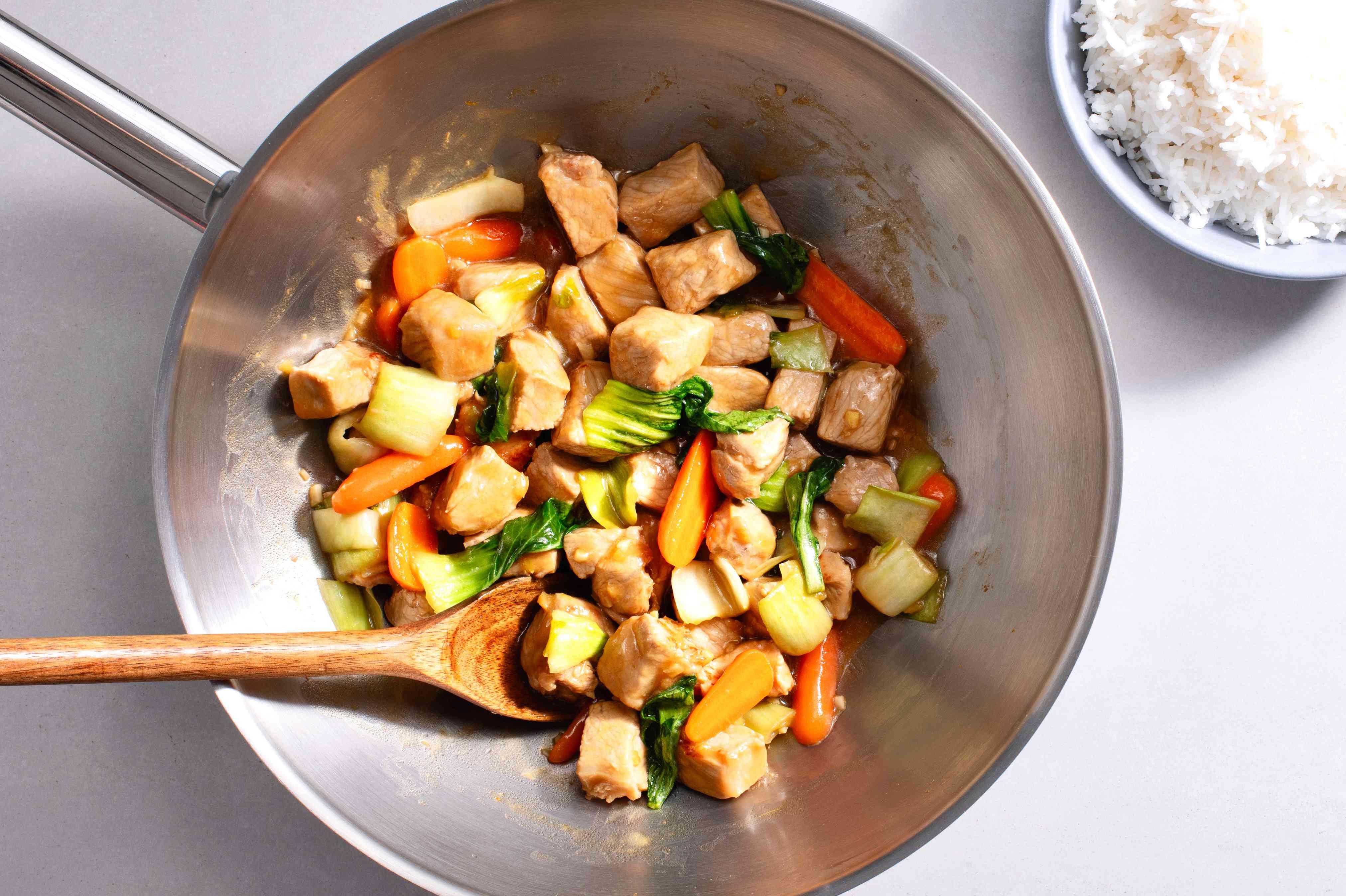 Chinese Orange Pork Chop Stir-fry in a wok