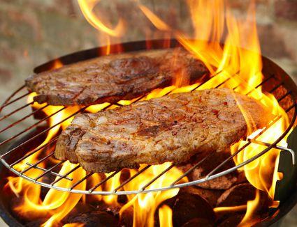 Pork steak grilling
