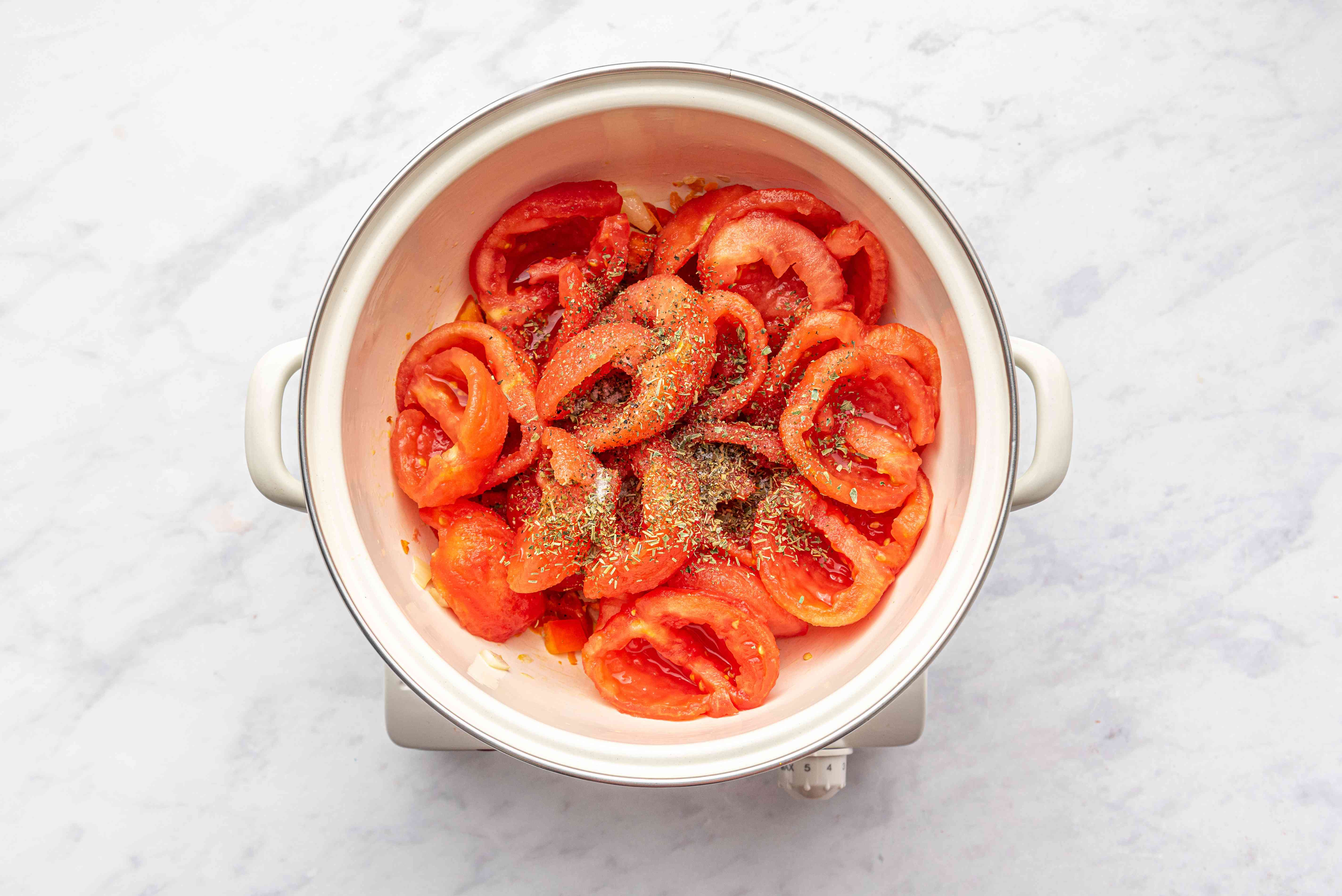 Tomatoes added to the pot