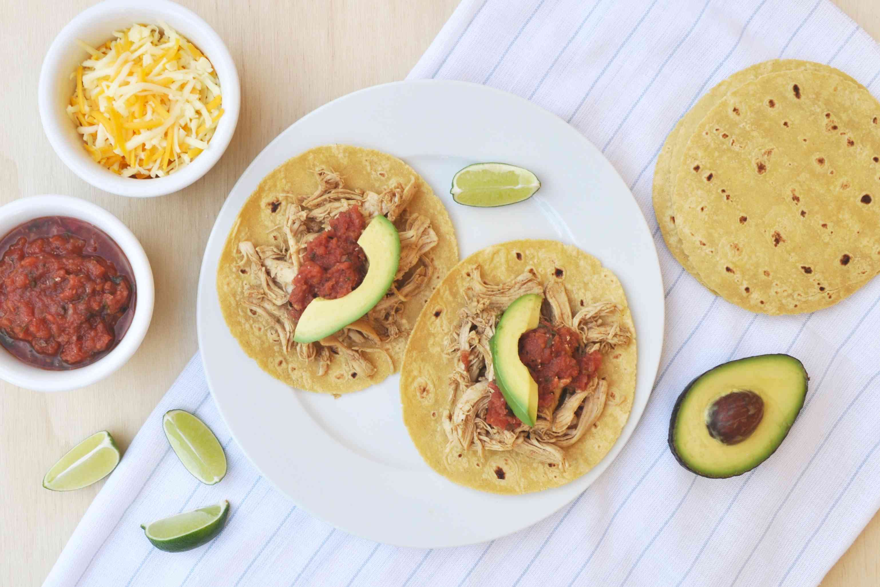 Pulled chicken tacos with garnishes