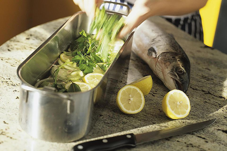 Making herb marinade for salmon trout