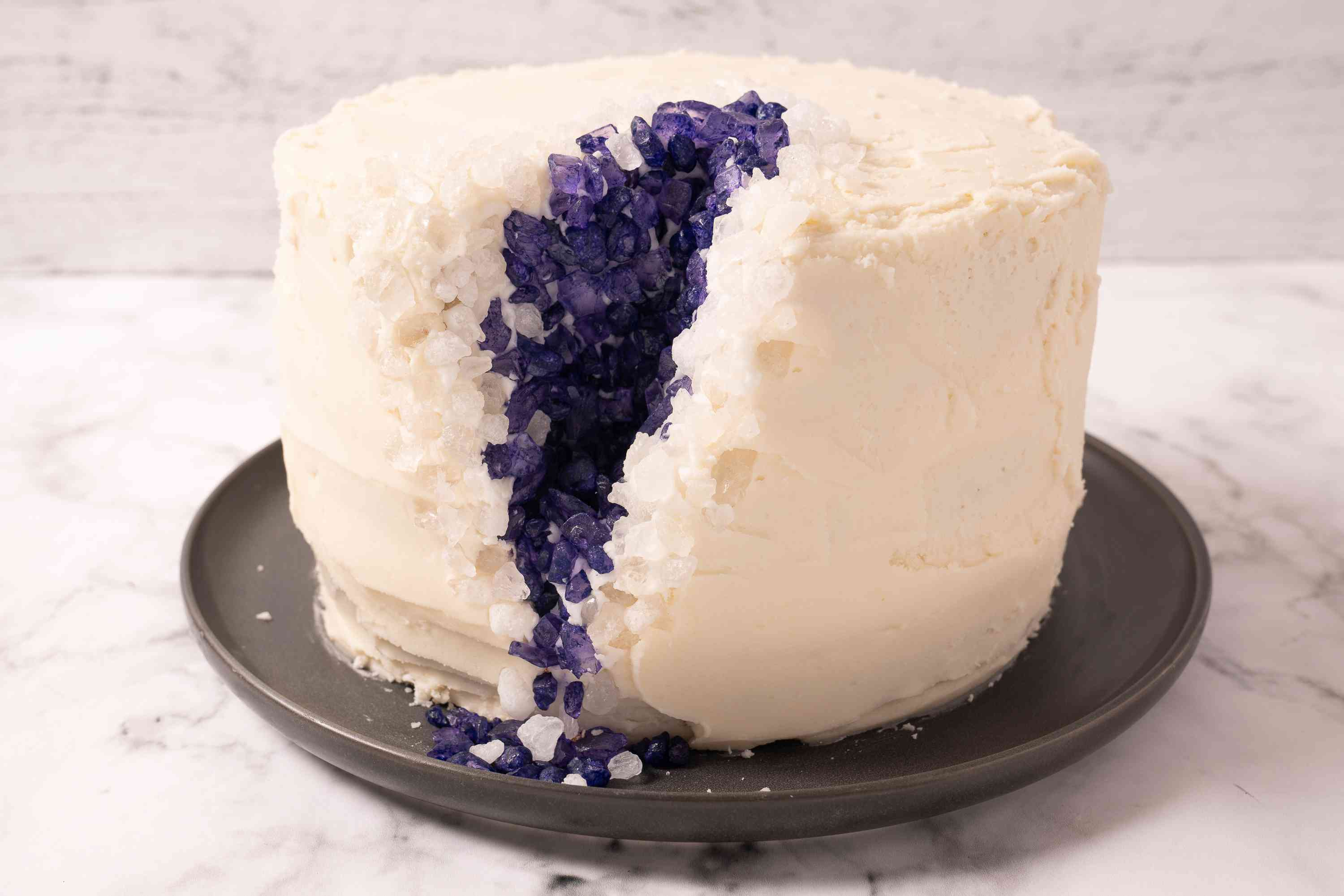 Purple rock candy is edged with white rock candy