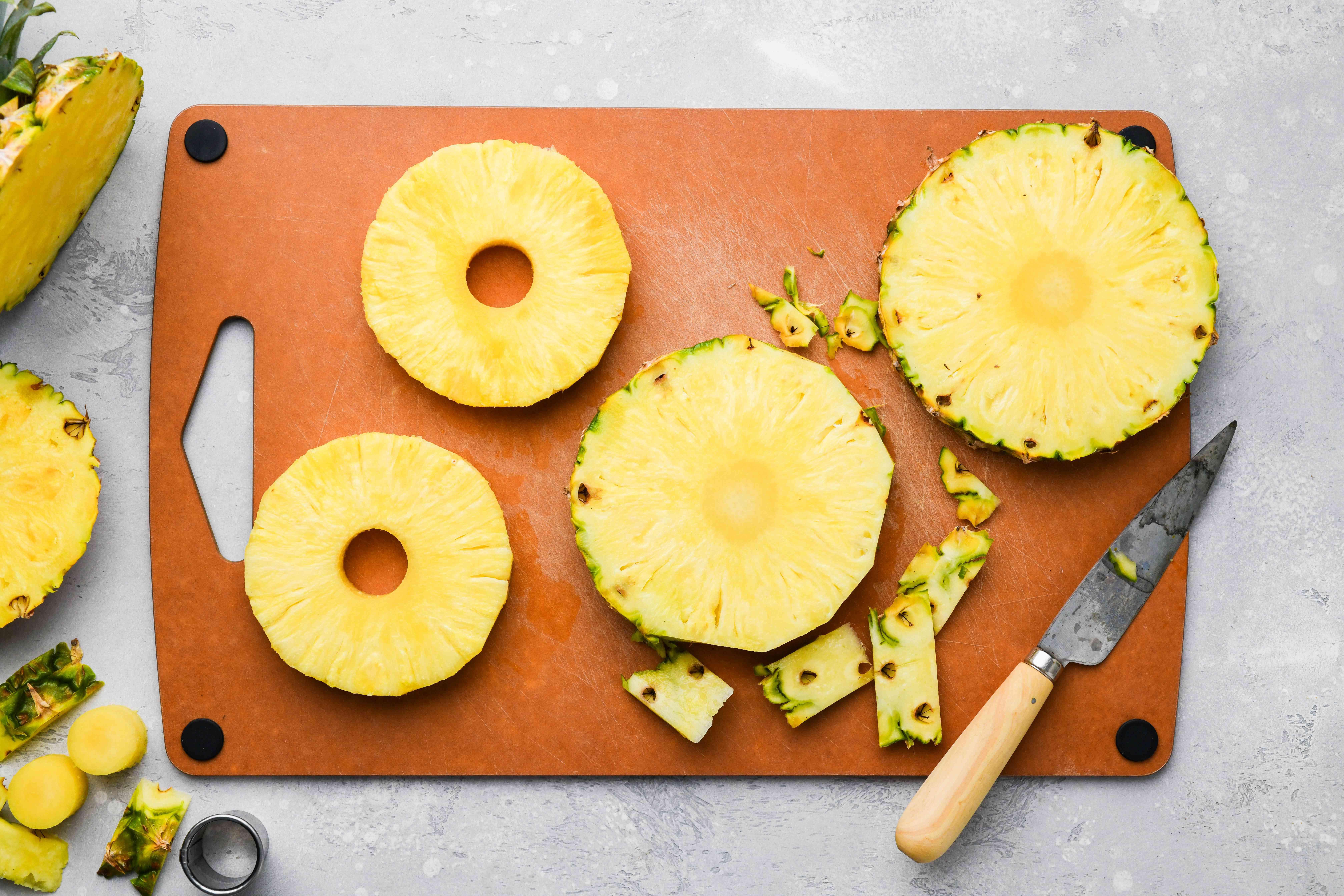 Peel, slice, and core pineapple