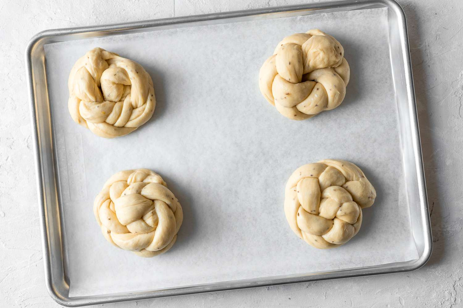 braided dough shaped into a circle