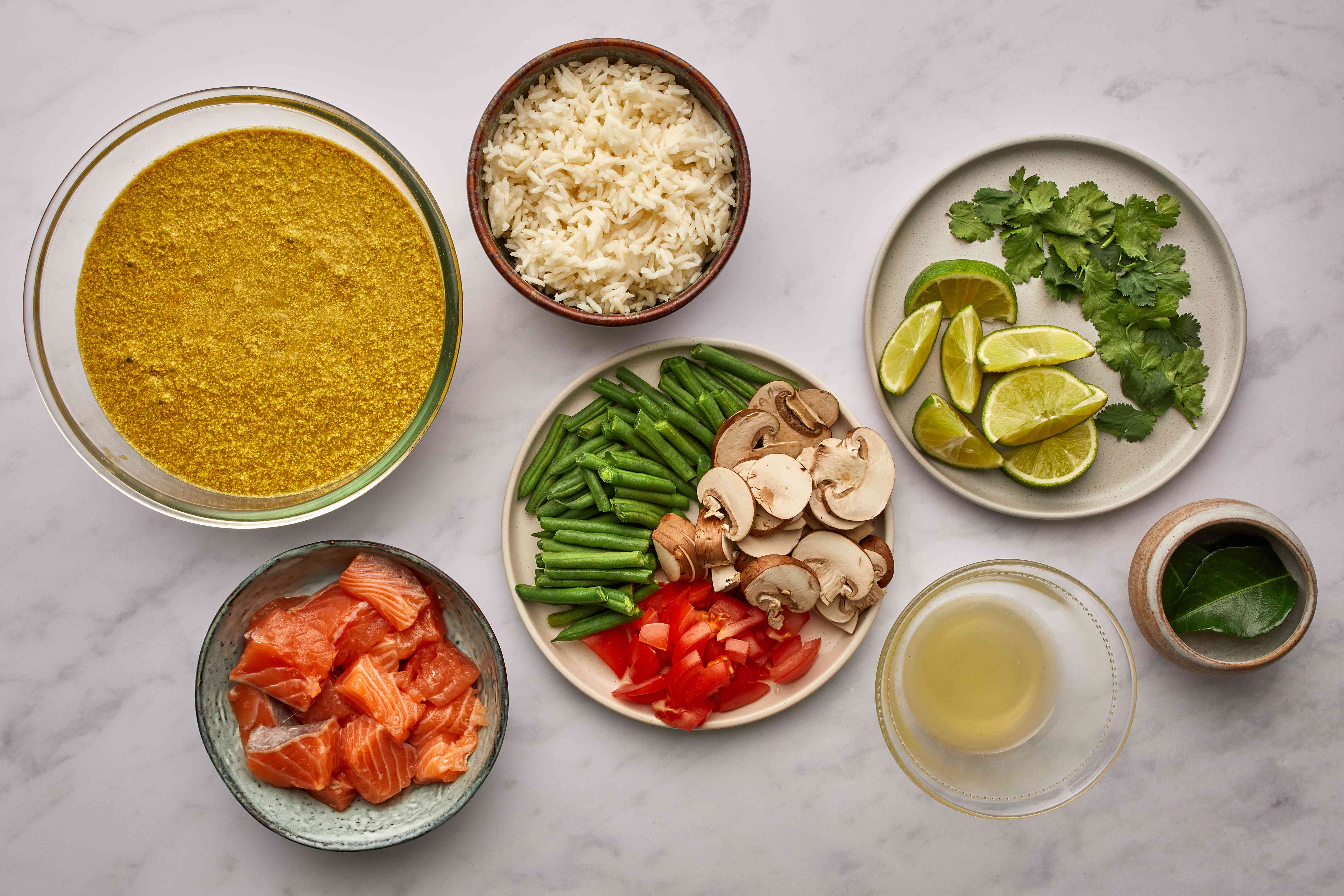 curry ingredients prepped in separated bowls