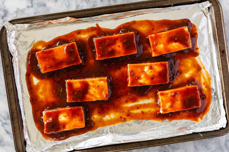 place tofu and coat