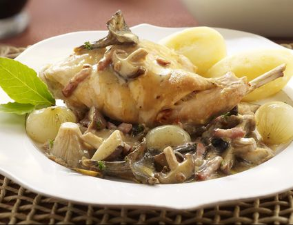 Rabbit with wild mushrooms, bacon and baby onion