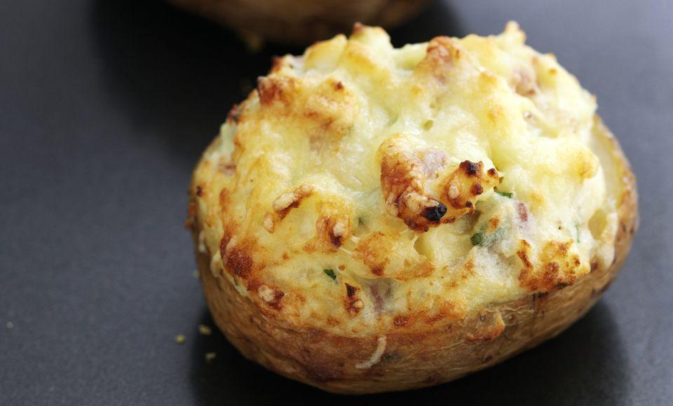 Baked potatoes on tray