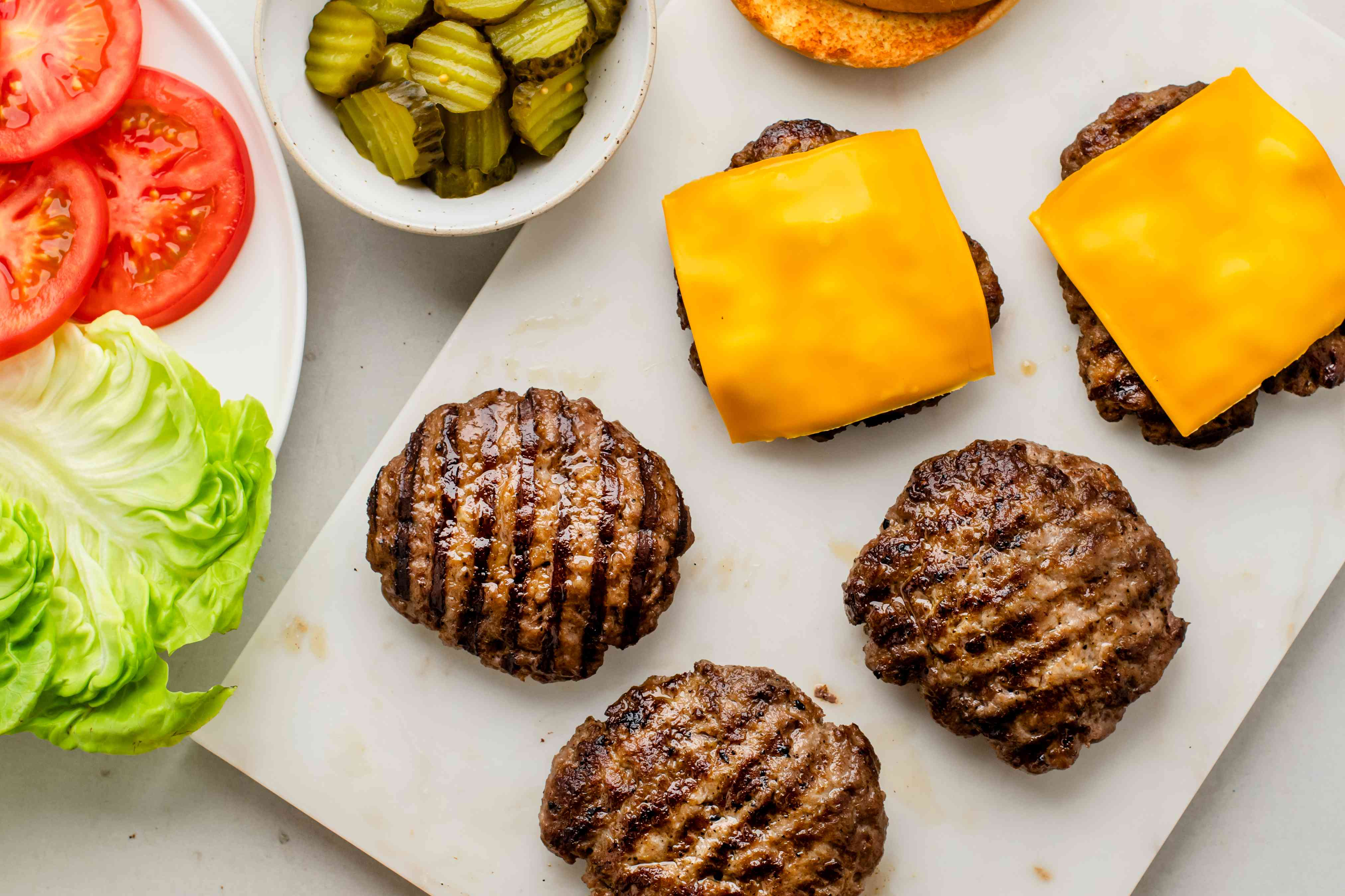 Serve the oven-baked burgers with condiments
