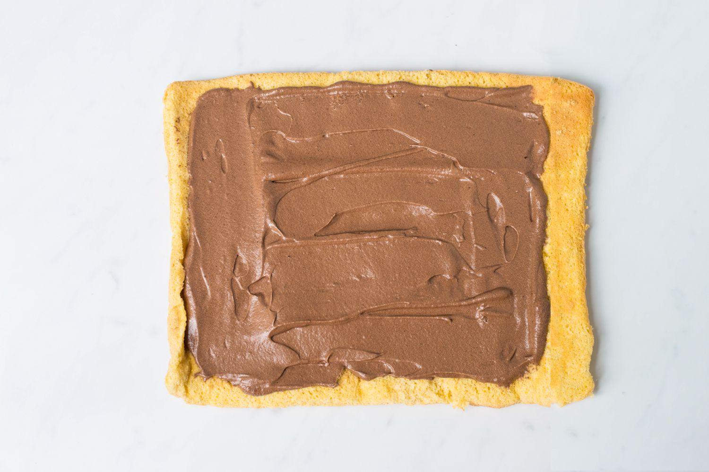 Buttercream spread on buche de noel cake.