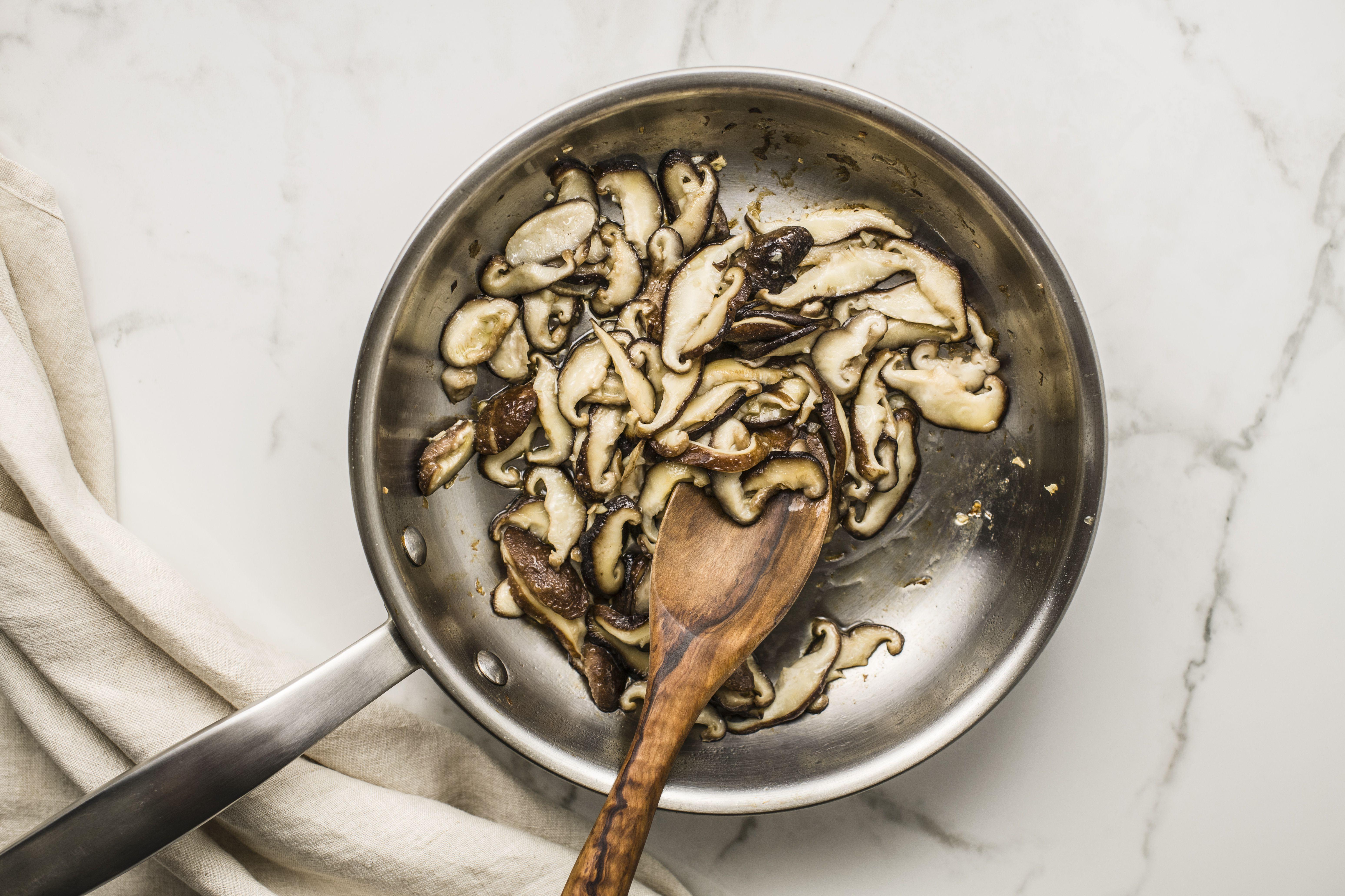 Melt butter and mushrooms