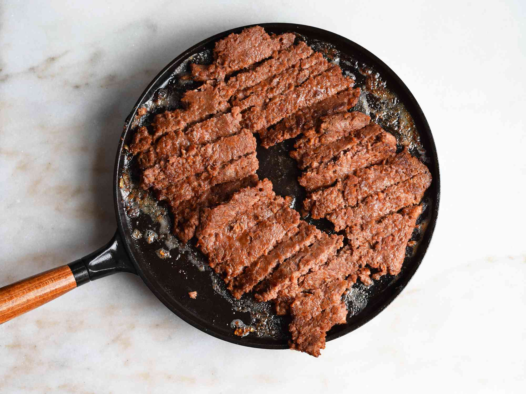 beyond meat cooked on a saute pan