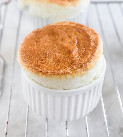 Vanilla soufflés in white ramekins