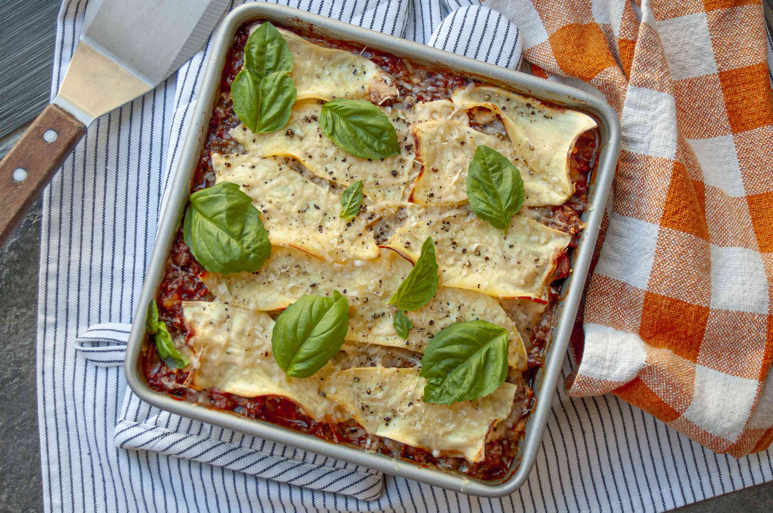 lasagna made with thiny sliced sweet potatoes instead of pasta topped with fresh basil leaves