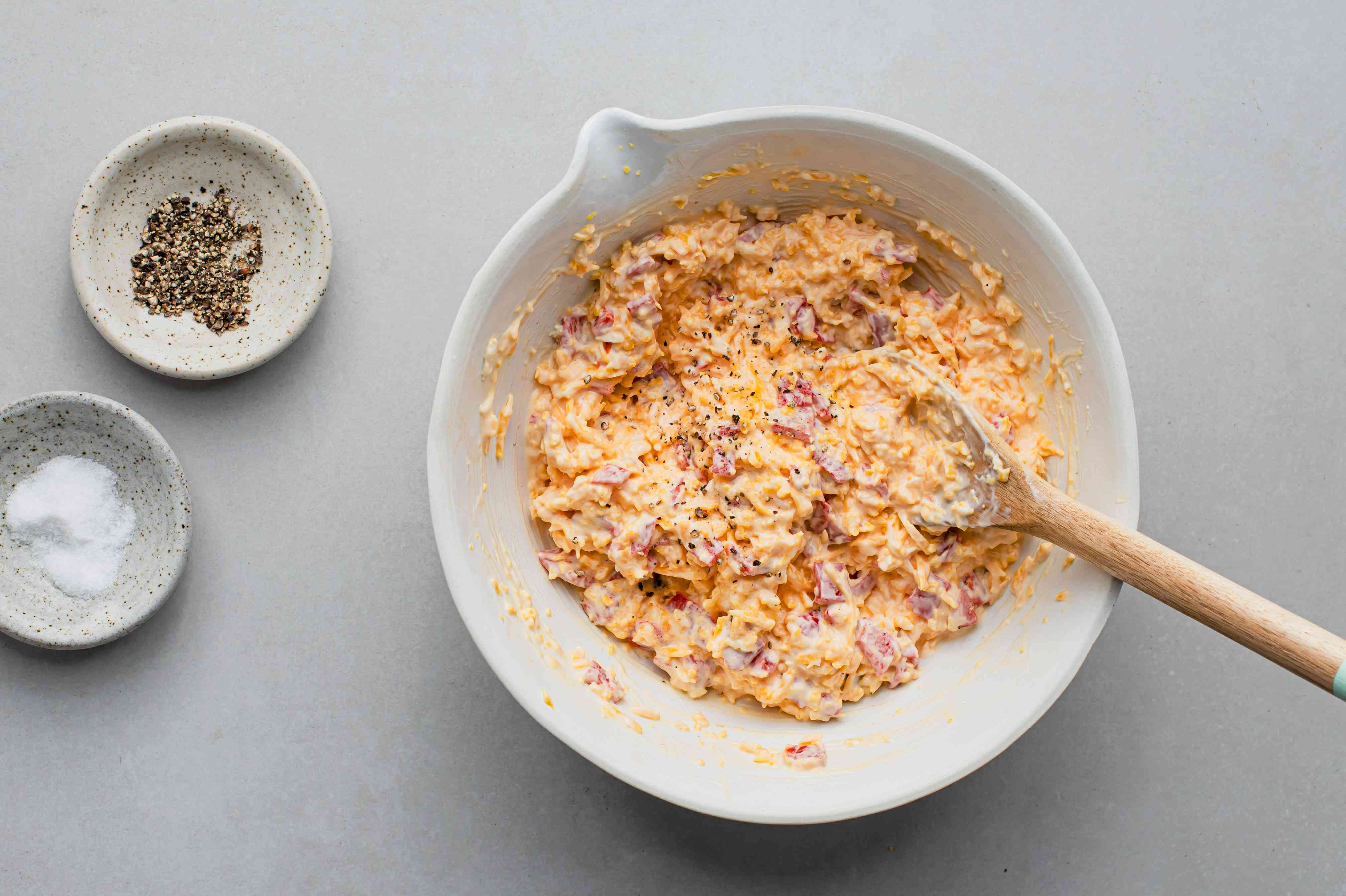 add pimientos to cheese mixture in bowl
