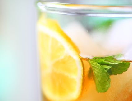 Close-Up Of Lemon And Mint Leaves In Ice Tea