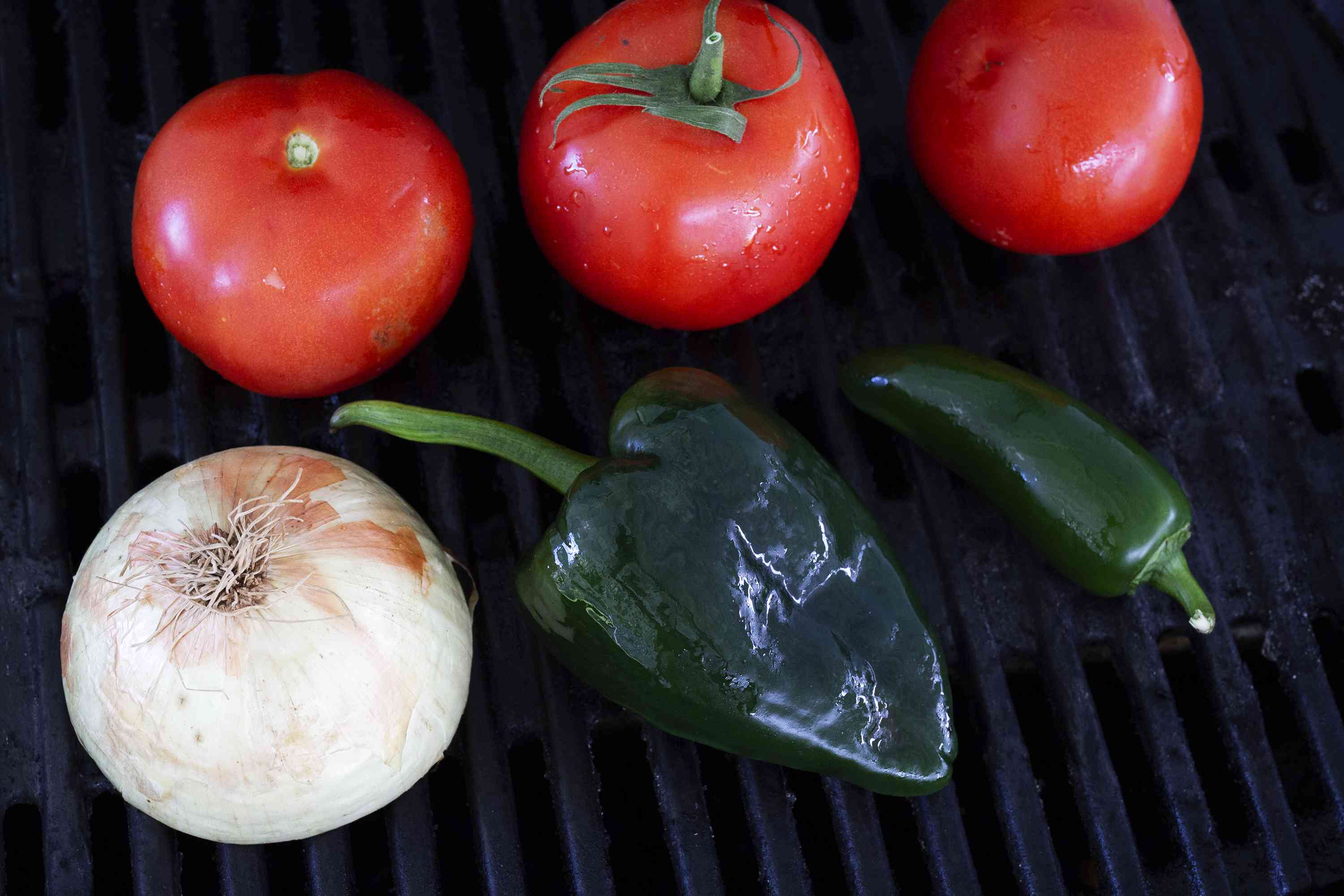 onion, tomatoes and peppers on the grill