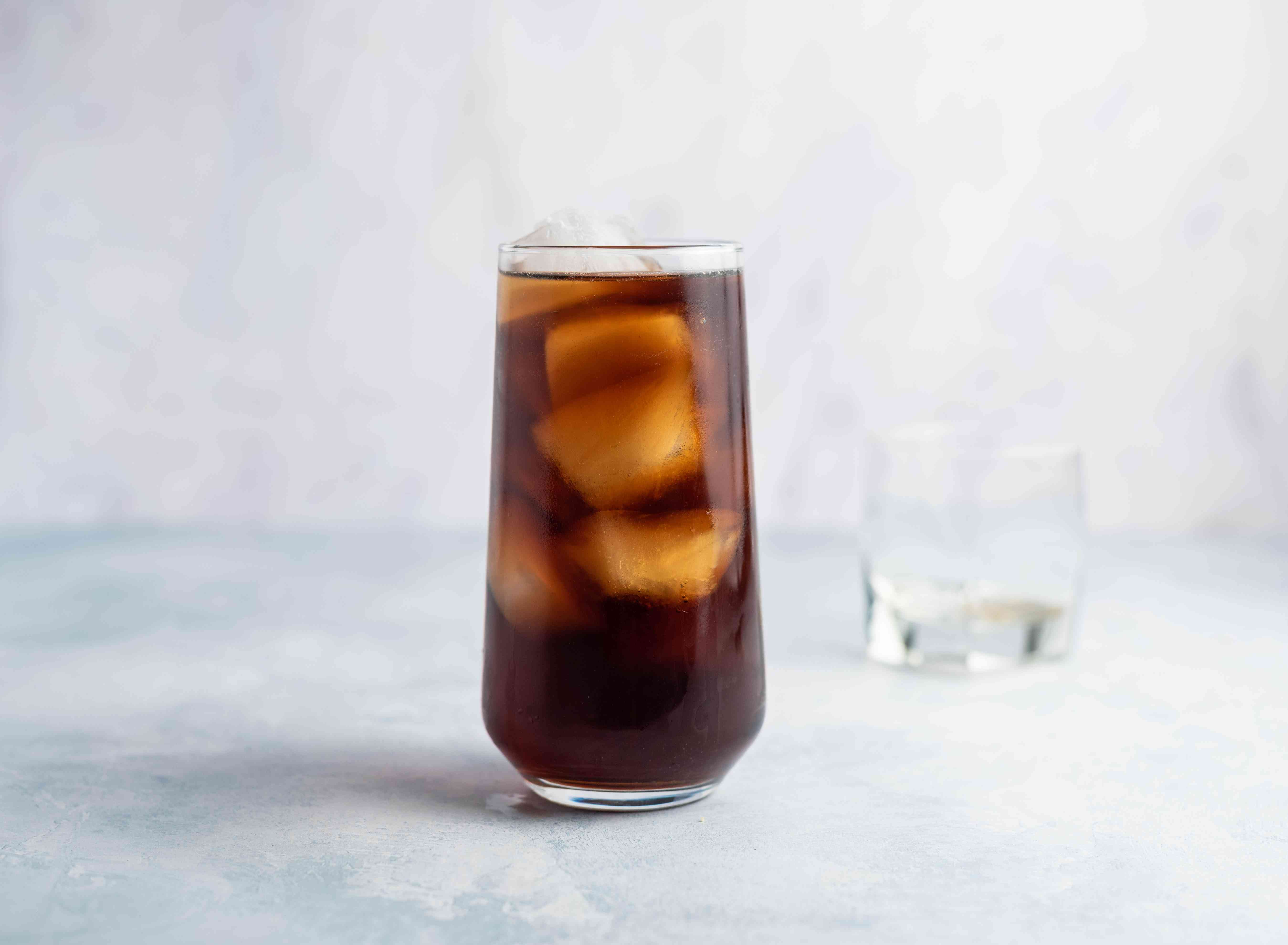 Cola is added to the ice and rum