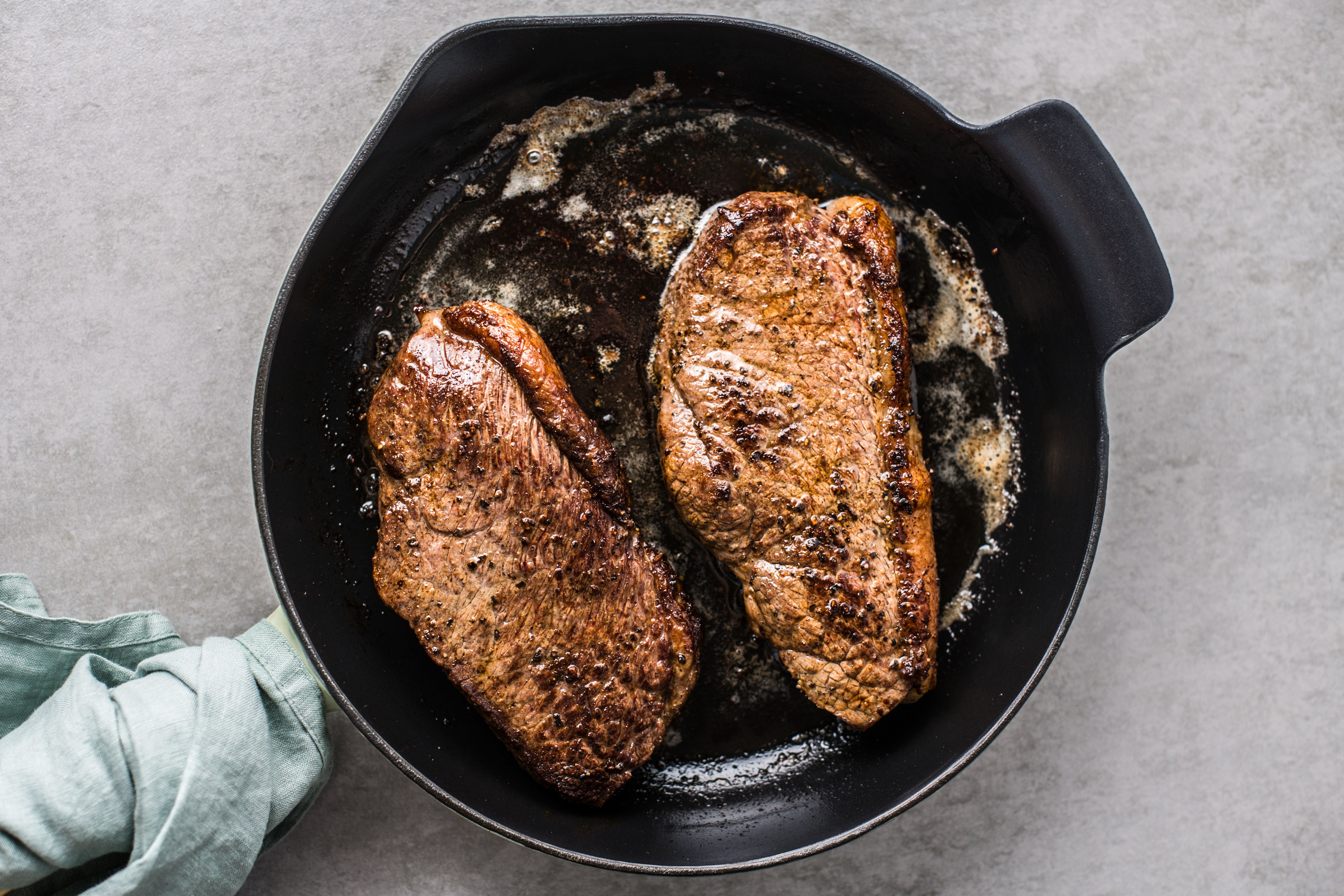 Cooked steaks in a pan