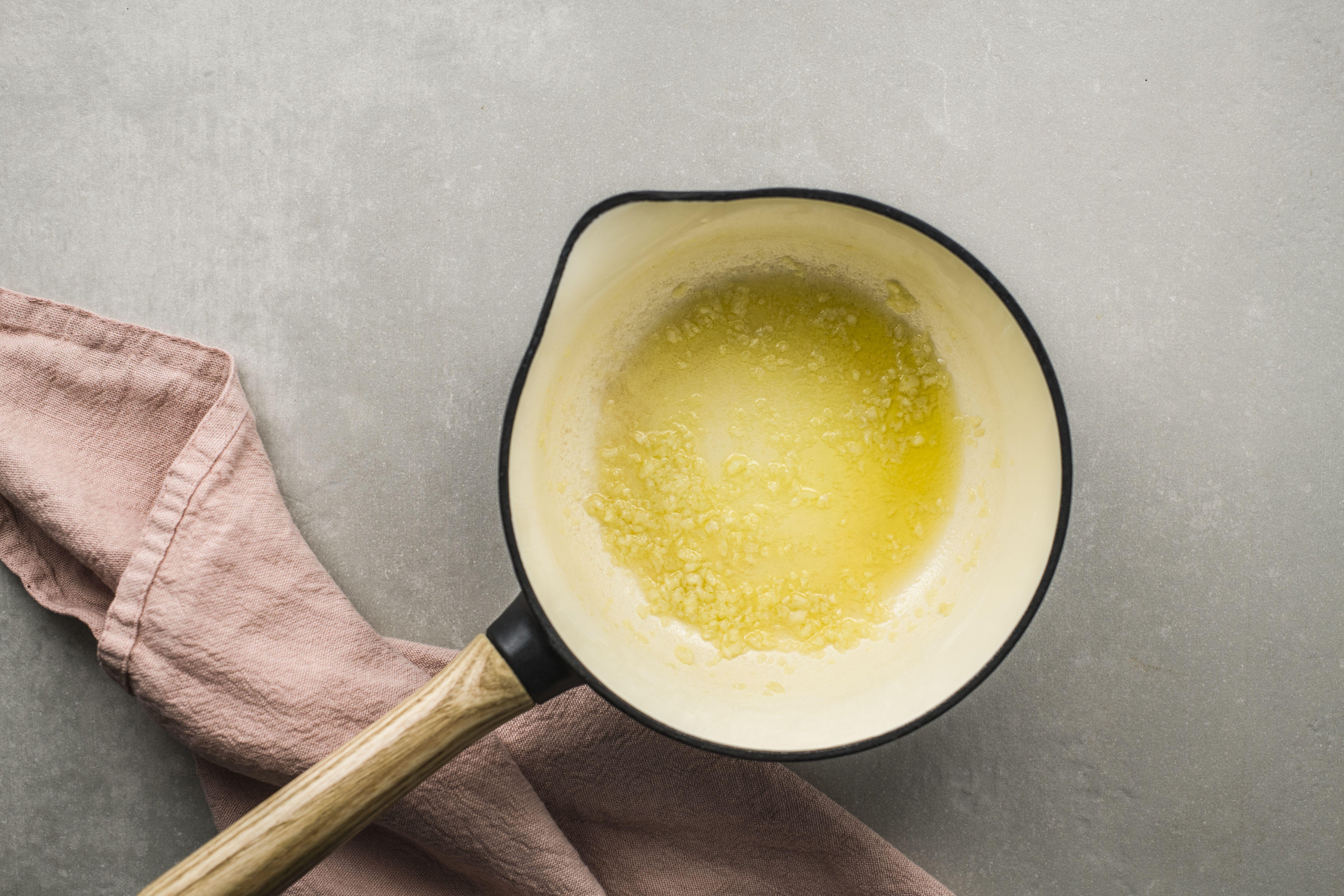 Foaming butter and garlic in a saucepan