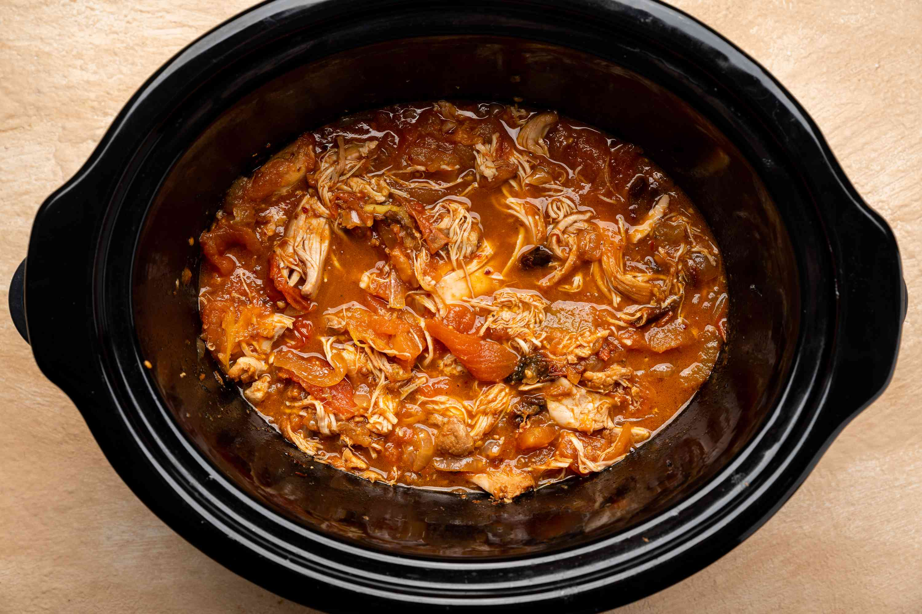 chicken shredded with sauce in crockpot