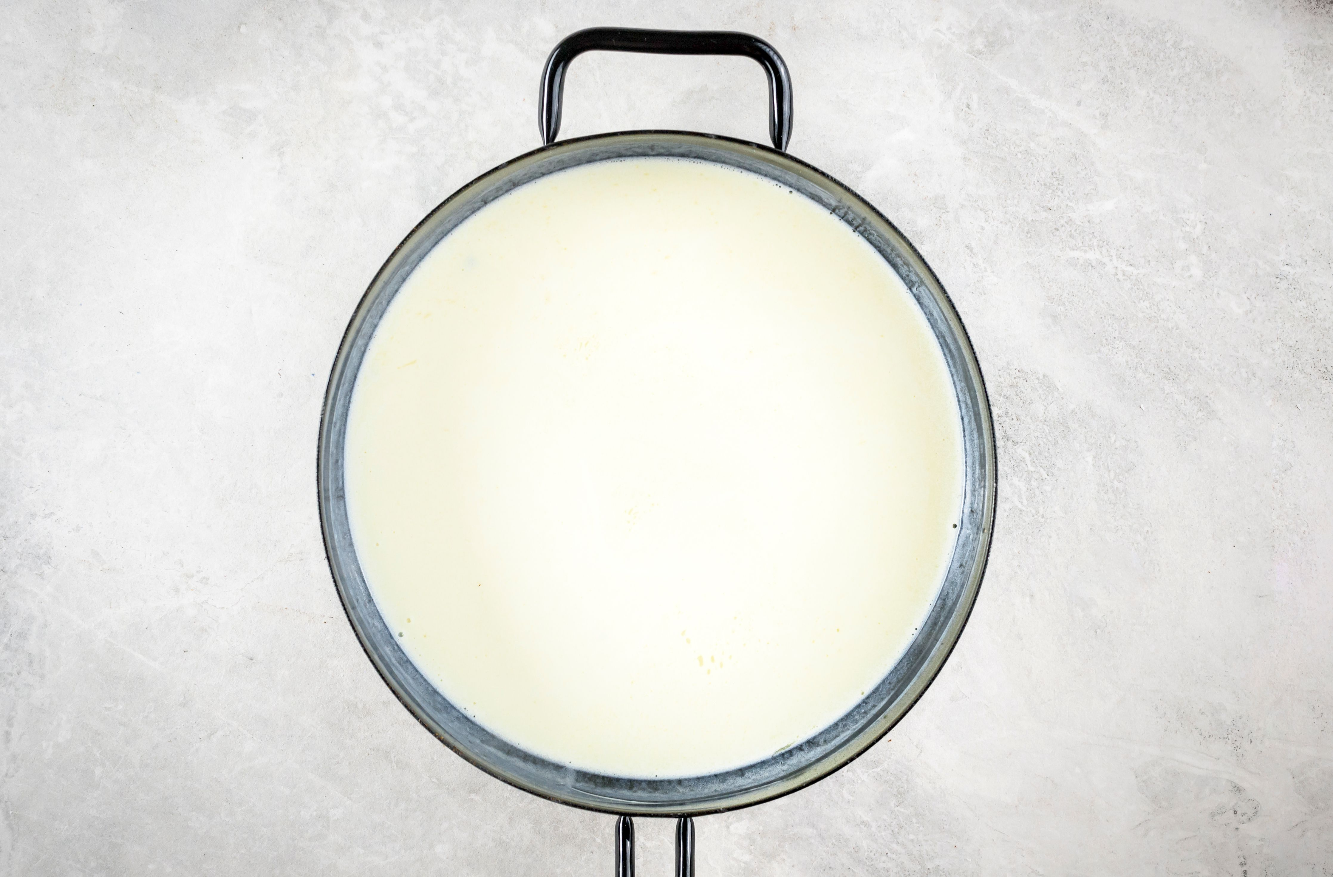 Lower the heat on the cream and butter and simmer gently
