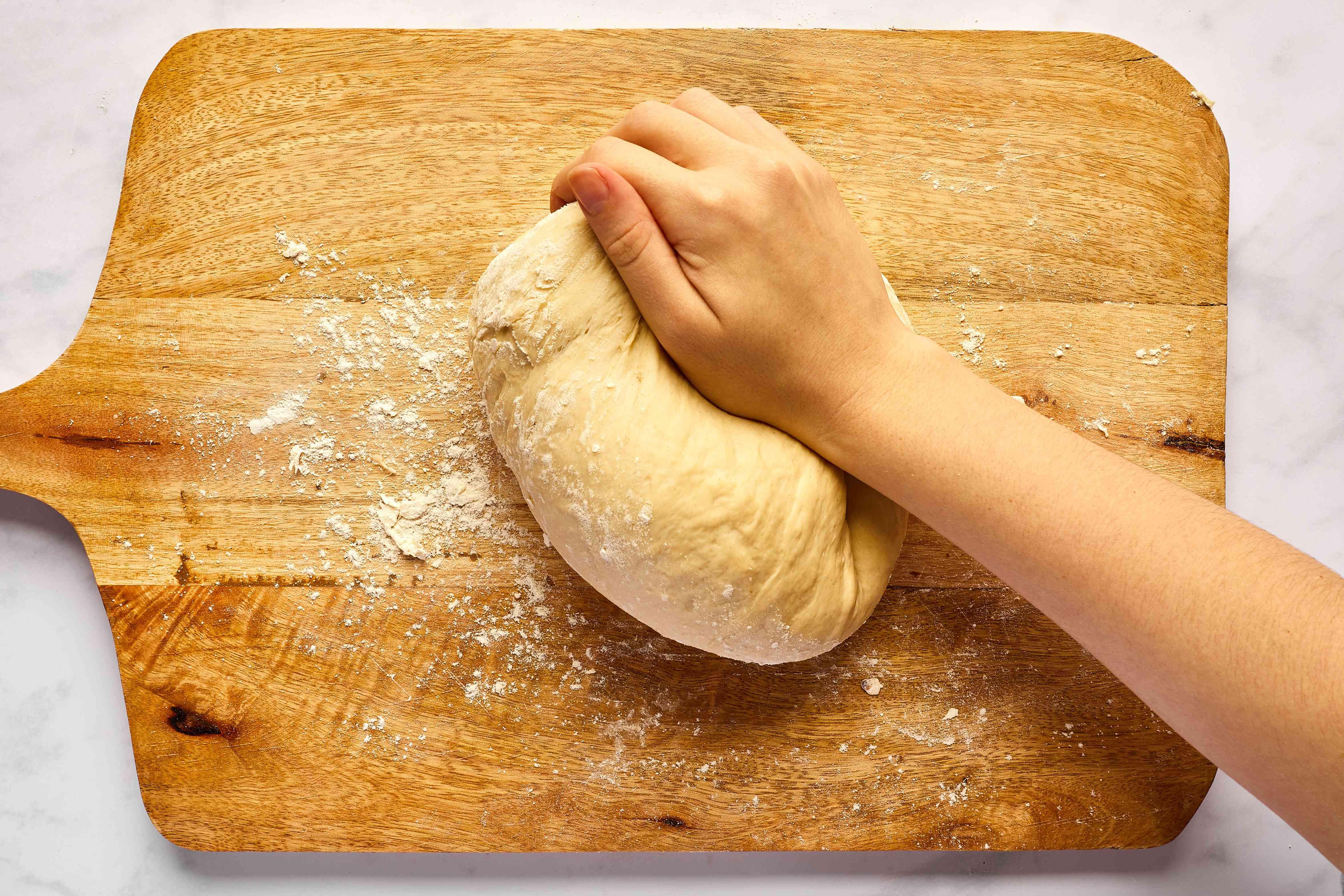 knead dough on a floured surface