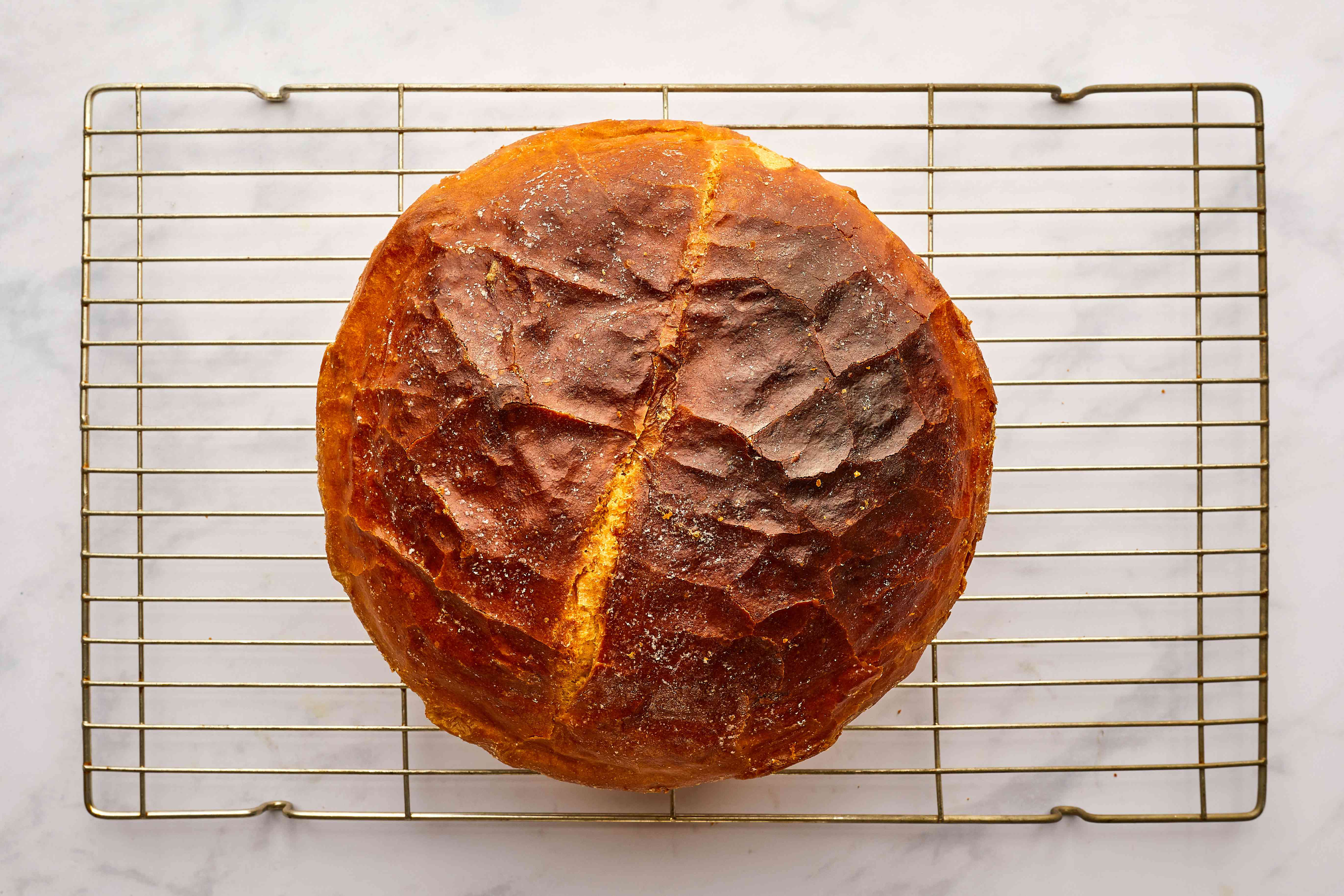Round White Bread on a cooling rack