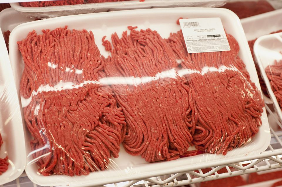 Ground beef with label on shelf