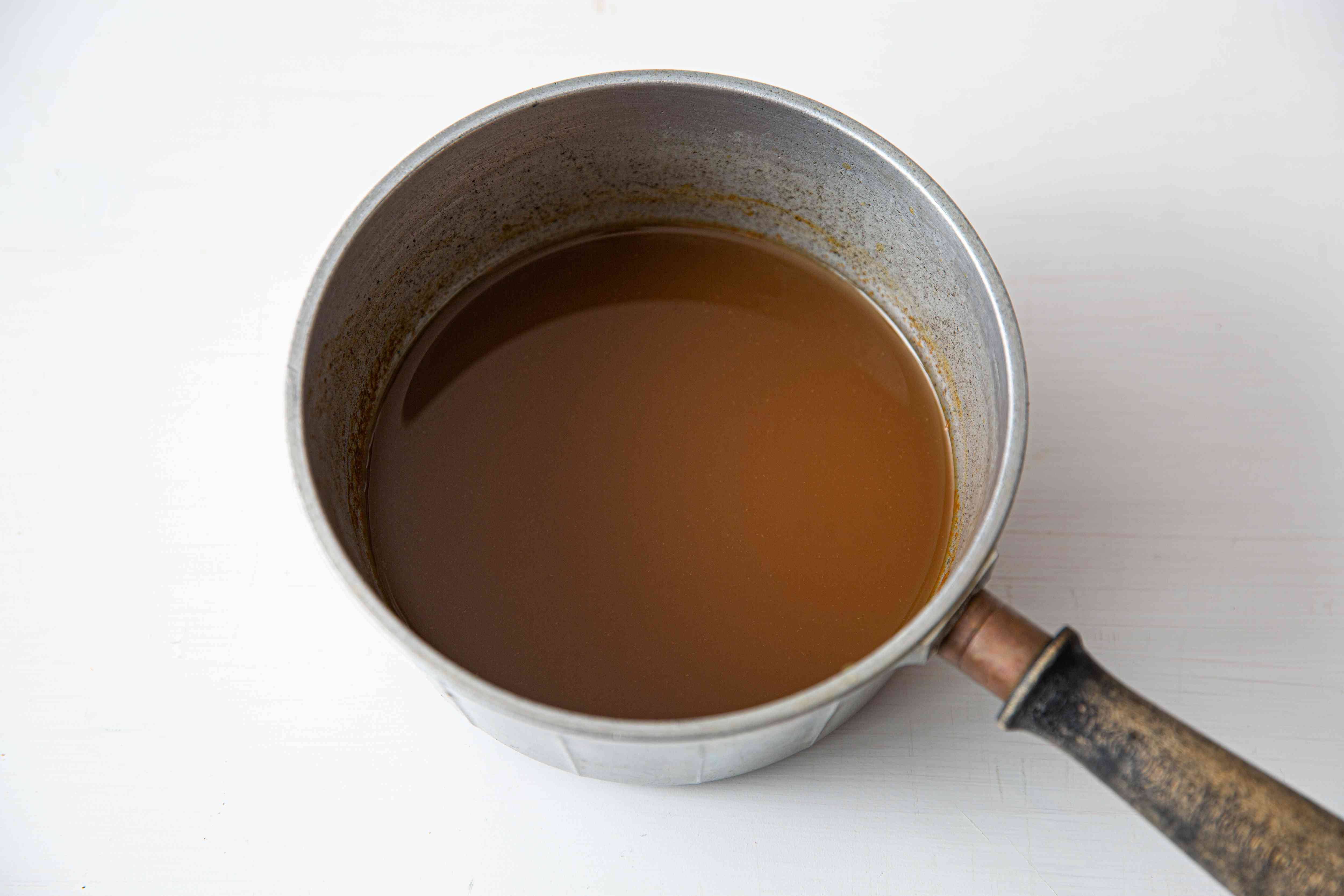 Apple cider in a small saucepan