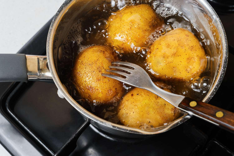 Potatoes boiling in a pot