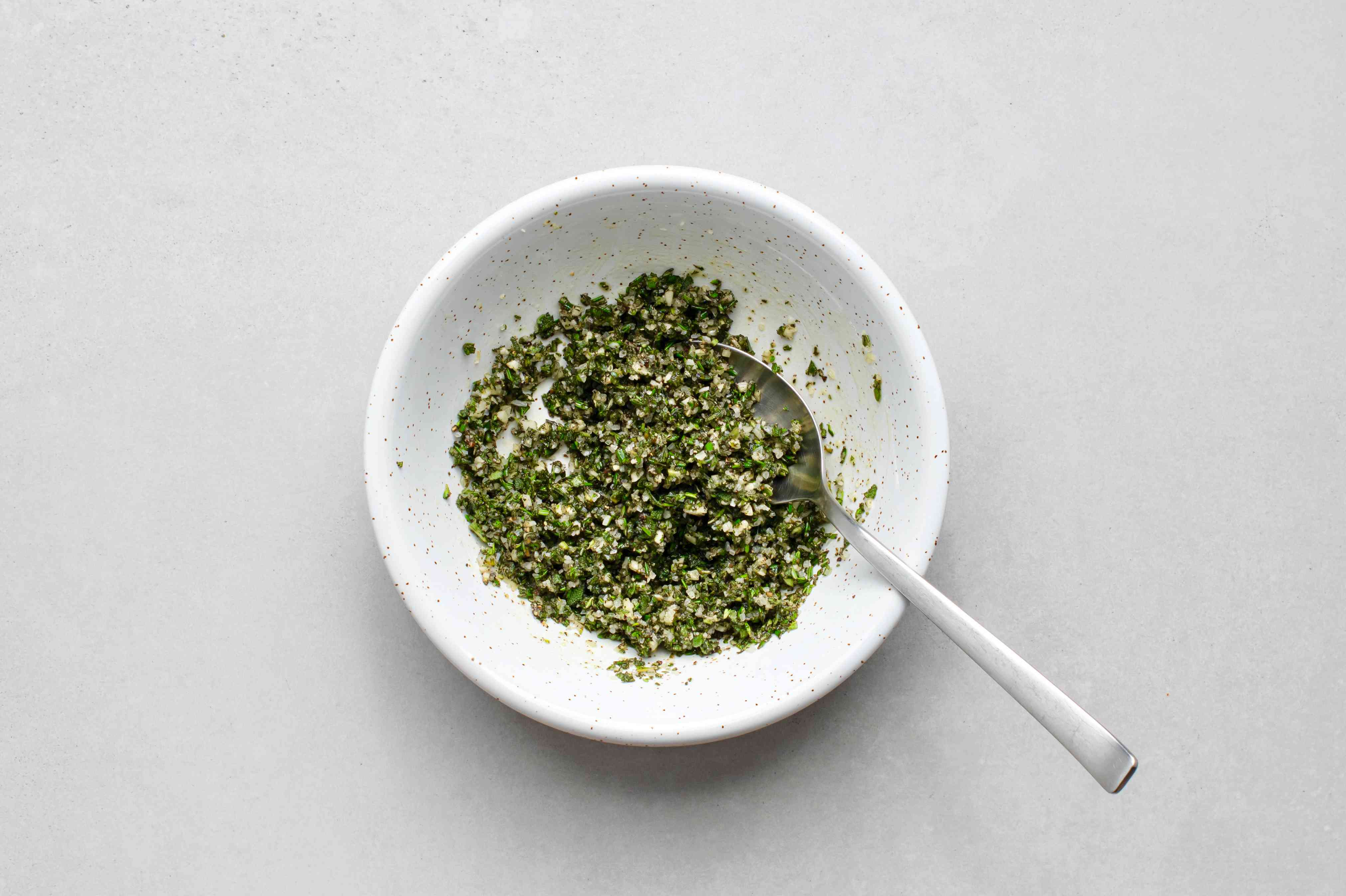 oil, garlic, salt, pepper, sage, rosemary, and thyme in a bowl