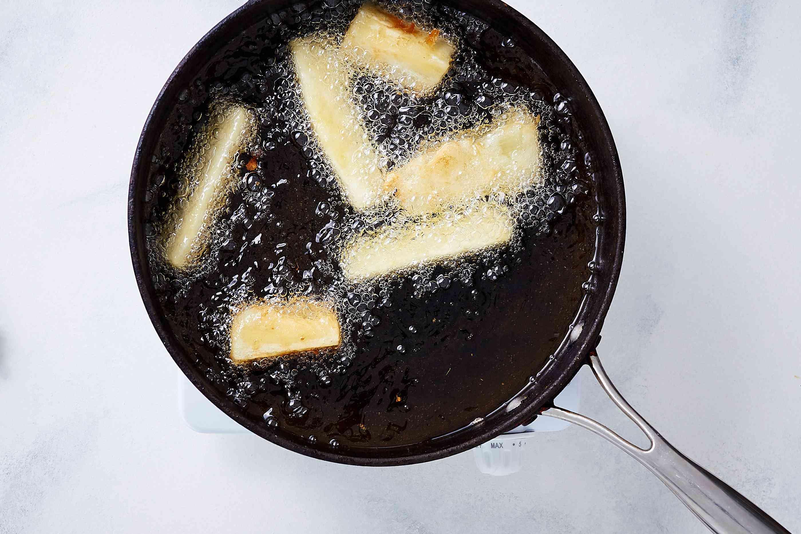 yuca pieces frying in oil