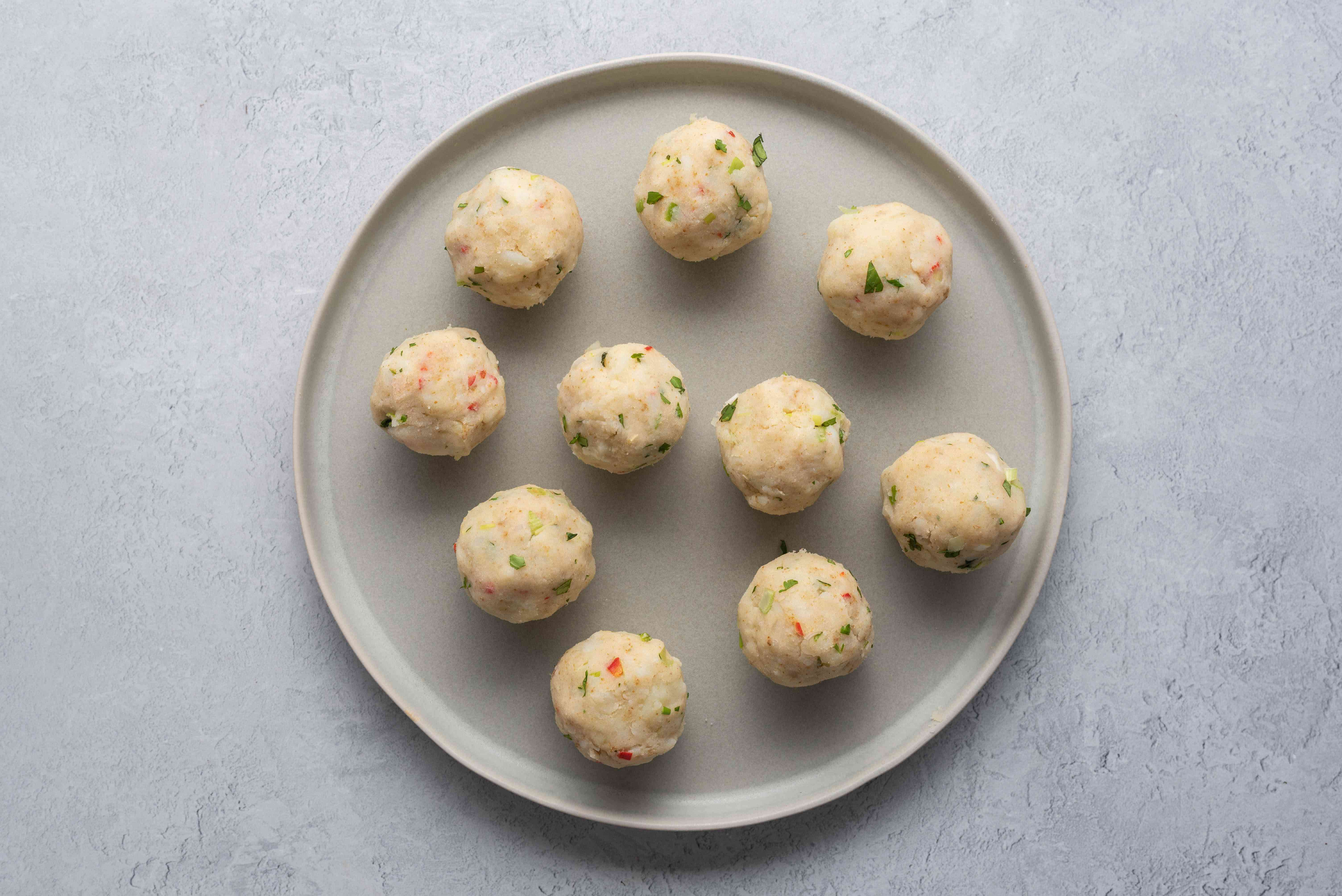 A plate of formed mashed potato balls