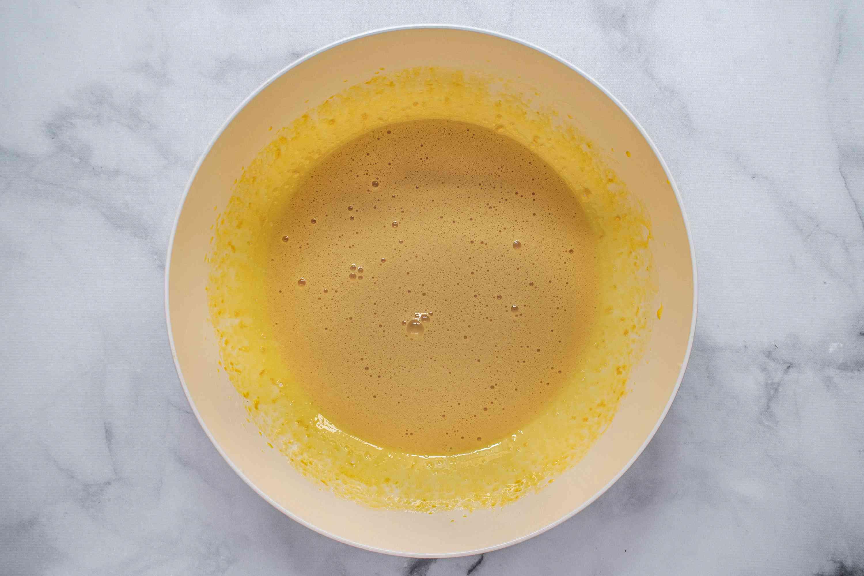 Beaten egg yolks, sugar, vanilla, and lemon zest in a bowl