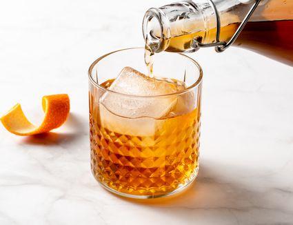 Homemade Amaretto Liqueur poured into a glass