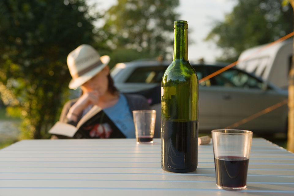 Wine and woman reading