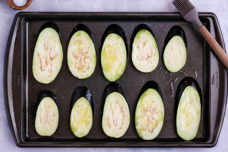 Lay eggplant on baking sheet