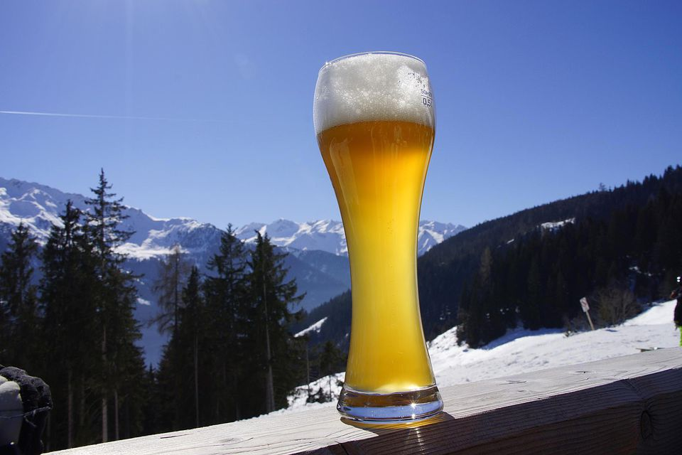 Wheat beer in alpine landscape